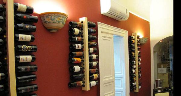 Andrea sapori montani palazzolo acreide interno ristorante con bottiglie